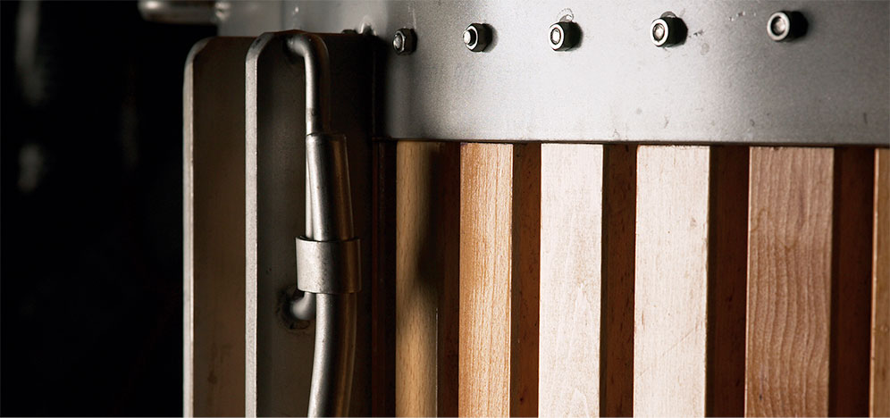 A close-up of a wine press basket
